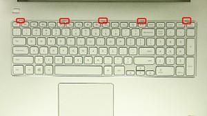 Press the keyboard latches in and loosen the keyboard.