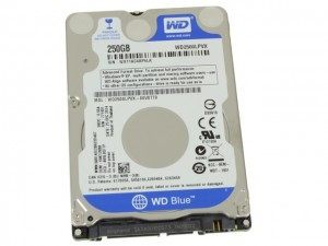 Remove the rubber covers from the hard drive.