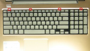 Using a flat head screwdriver or plastic scribe, press in the keyboard clips to loosen the keyboard.