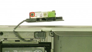 Remove the 1 - M2 x 3mm screw.