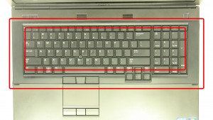 Carefully unsnap the Keyboard Bezel starting at the top of the keyboard.
