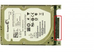 Remove the hard drive caddy screws on both sides of the hard drive.