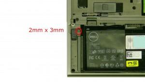 Remove the primary hard drive latch screw.