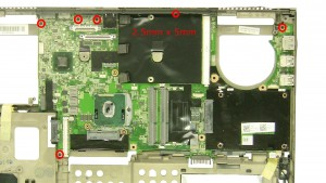 Remove the 6 - M2.5 x 5mm motherboard screws.