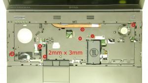 Remove the 11 - M2 x 3mm palmrest screws.