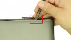 Using a scribe, carefully pry up and unsnap the bottom cover access door.