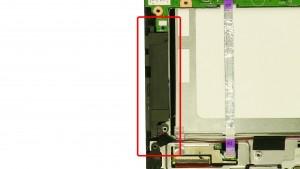 Loosen the left speaker & speaker cables.