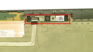 Carefully pry up the camera. It may be glued or taped down so a plastic scribe or small flat head screwdriver may be needed for removal.