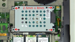 Remove the hard drive screws and lift the hard drive out of the laptop (4 x M2.5 x 8mm).