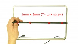 Remove the screws on the top and bottom of the screen (8 x 1x3mm T4 torx).