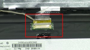 Peel back adhesive and remove LCD cable.