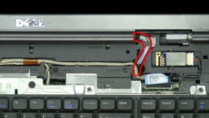 Pull the antenna cables through the laptop base.
