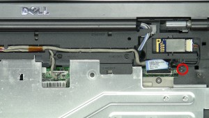 Loosen the LCD cable screw.