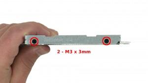 Remove the 4 - M3 x 3mm hard drive caddy screws.