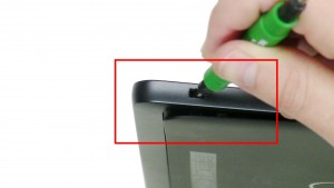 Using the access point, pry up and unsnap the bottom cover.