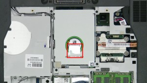 Using the tab, slide the hard drive up and lift it out of the laptop.
