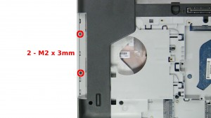 Remove the 2 - M2 x 3mm screws under the optical drive.