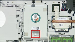 Use the pull tab to slide the Hard Drive down and unseat it from the motherboard.