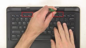 Use flat head screwdriver to pry open and remove Keyboard Bezel.