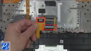 Turn over ribbon and unplug keyboard connectors.