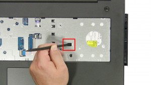 Slide the DVD Optical Drive over & remove it from the laptop.