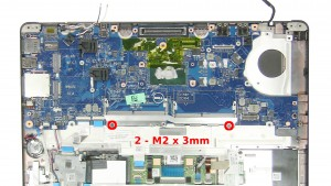 Remove the 2 - M2 x 3mm motherboard screws under the memory slots.