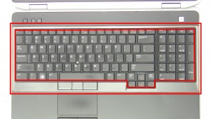 Using a small flat head screwdriver or plastic scribe, carefully pry up & unsnap the Keyboard Bezel.