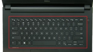 Press in tabs and turn over Keyboard.