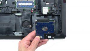 Unscrew and remove Hard Drive (4 x