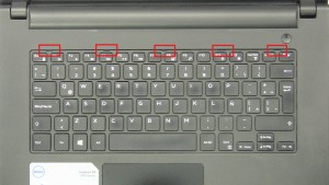 Press in tabs to separate and turn over Keyboard.
