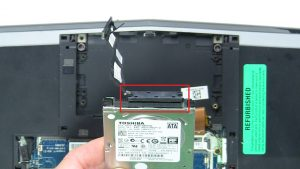 Unscrew and remove Hard Drive (4 x