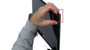 Use fingers to pry apart and separate LCD back from display panel.