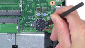Use thin object to pry out CMOS Battery.