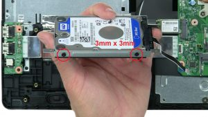 Unscrew and remove hard drive caddy (4 x M3 x 3mm).
