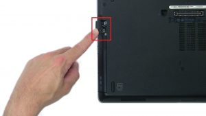 Press in button and remove DVD Optical Drive.