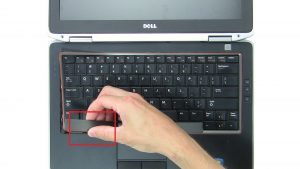 Use fingers to pry apart and remove Keyboard Bezel.
