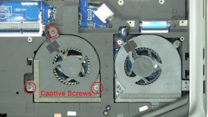 Unscrew cooling fan (captive screws - cannot be removed).