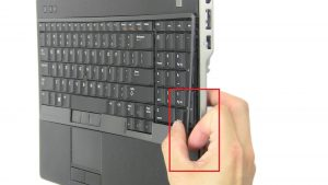 Use fingers to separate and remove Keyboard Bezel.