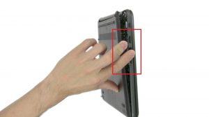 Peel off screw covers and loosen captive screws .