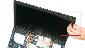 Use fingers to gently unsnap and separate LCD Bezel.