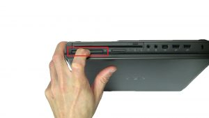 Press in with finger to release and then remove Express Card.