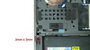 Unscrew and slide over locking mechanism to release hard drive (1 x M2 x 3mm).