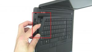 Use fingers to gently unsnap and remove Keyboard Bezel.