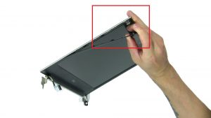 Use fingers to carefully separate and remove Display Bezel.