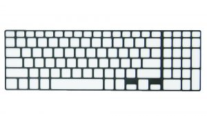 Use plastic scribe to release tabs and remove keyboard bezel.