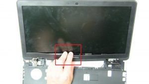 Use fingers to separate and remove Display Bezel.