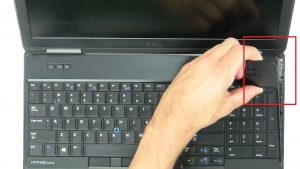 Use fingers to pry apart and remove Keyboard Trim.