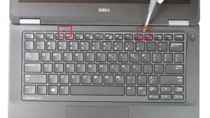 Use thin object to pry apart and remove keyboard bezel.