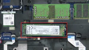 Unscrew bracket and remove Solid State Drive (1 x