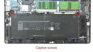 Unscrew and remove Battery (captive screws).